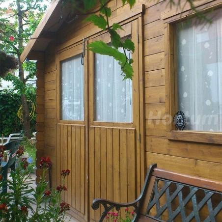 Detalle caseta de madera - jardín Manil