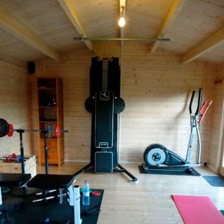 Interior gimnasio en caseta de madera para jardín Iris 19,1 m²